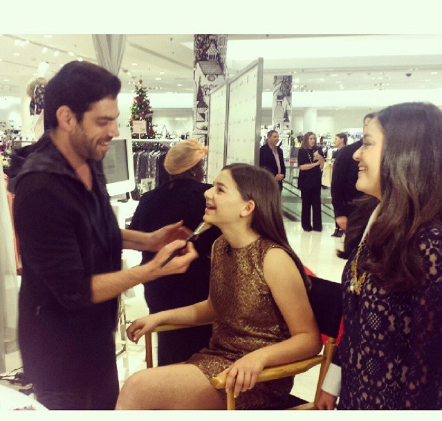 Rob Scheppy doing Ellas make up with Alex looking on